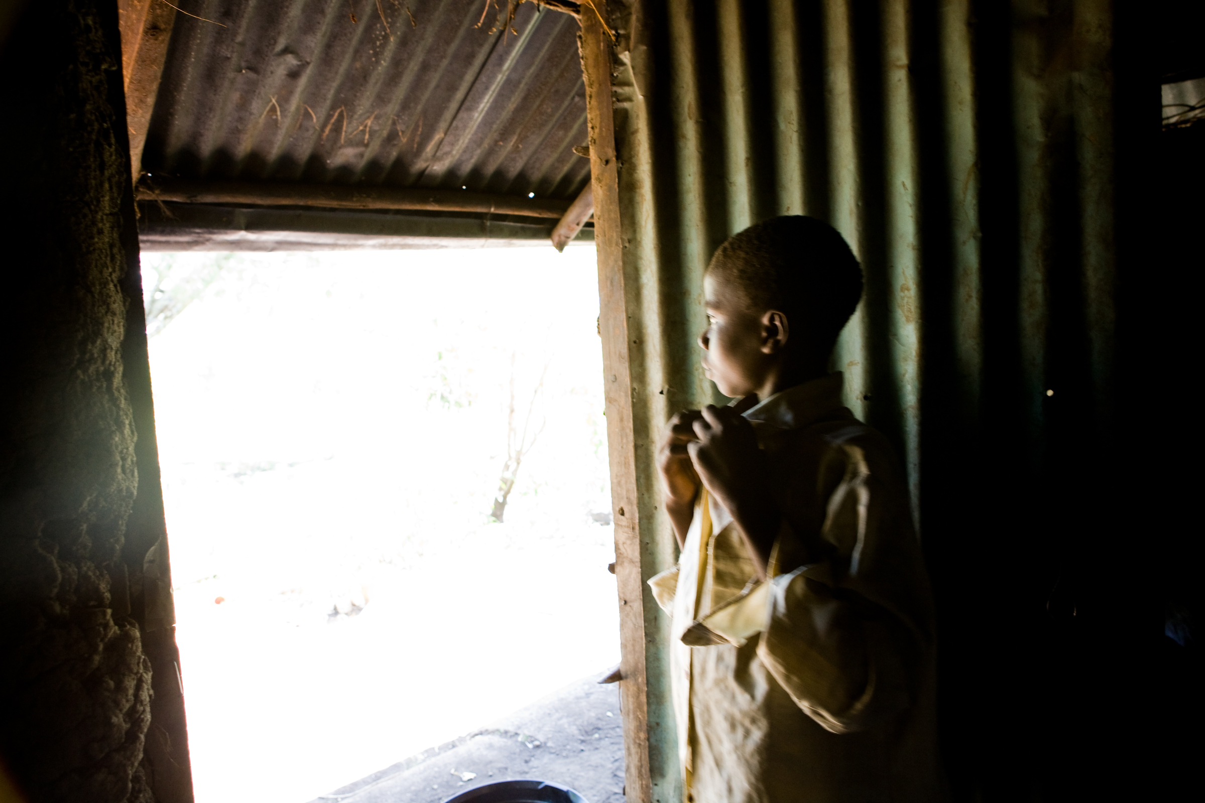 "Walter is 12 and Charles is 10. They are alone and they are invisible..""Nobody comes from the community to visit us here. They just look at us from the outside,"" Walter said looking out the door of the house. Image:brendanbannon.com"