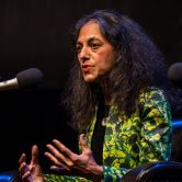 Nalini Nadkarni speaks into a microphone