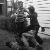 three boys fighting