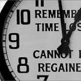 """Clock with caption, """"Remember time lost cannot be regained"""""""