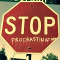 Stop Procrastinating sign