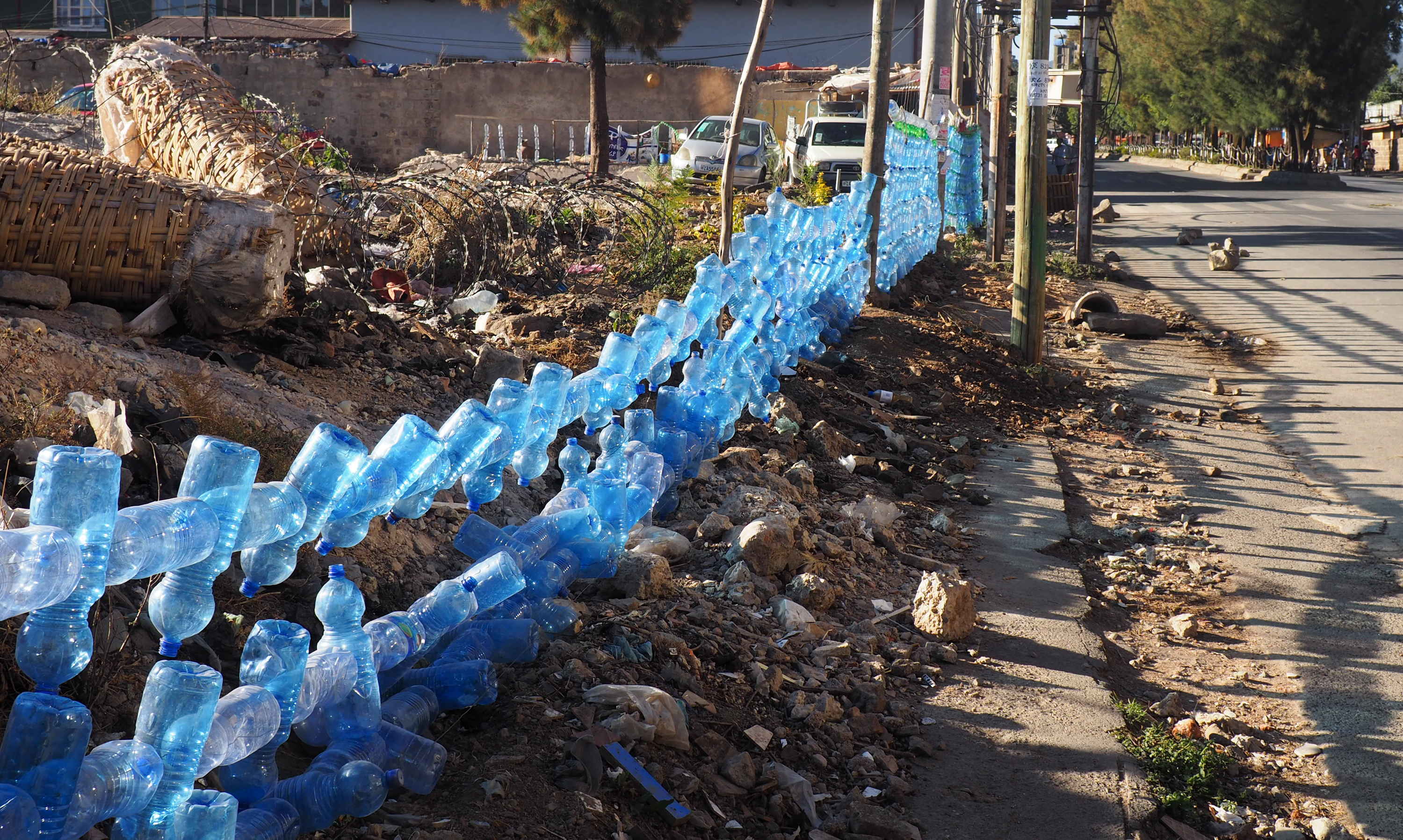Fence made of re-purposed plastic bottles -- a common sight in Addis