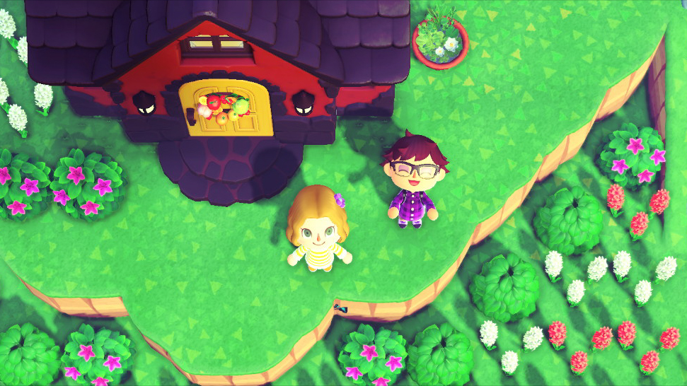 "Mark and Anne in front of Mark's ""Animal Crossing"" home. <em>Nintendo/Mark Riechers (TTBOOK)</em>"