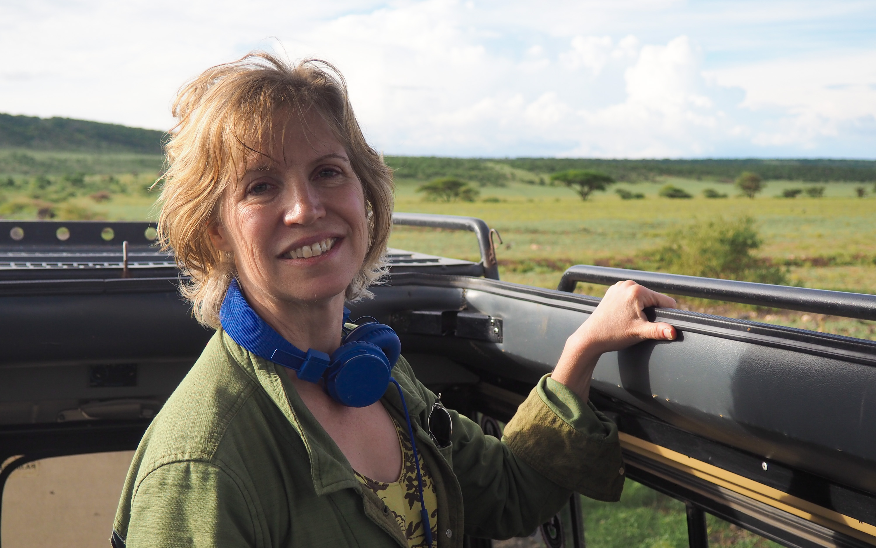 Anne looking out from our safari jeep. <em>Steve Paulson (TTBOOK)</em>