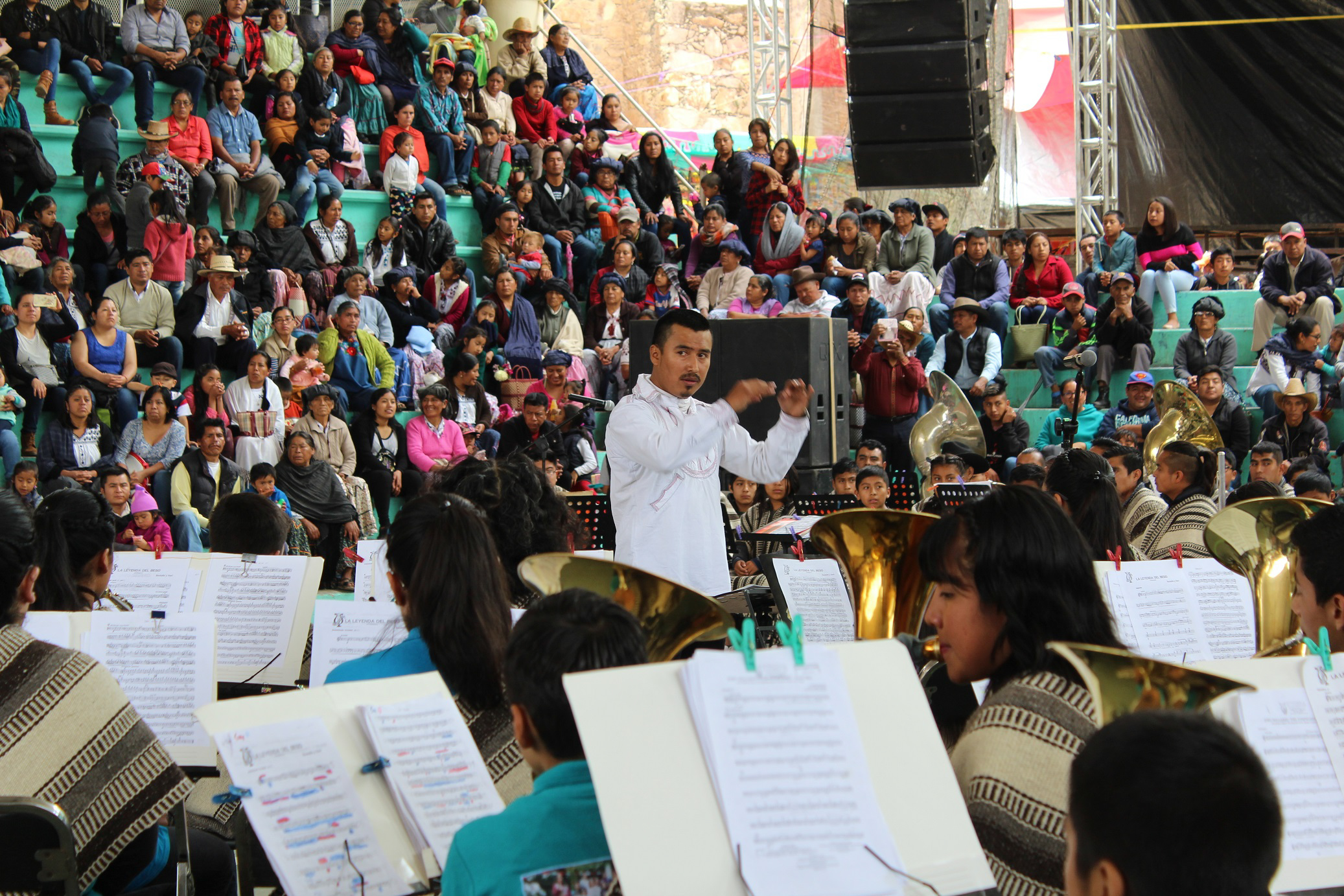 A conductor leads a youth band during a five-day festival in Santa María Tlahuitoltepec, a Mixe village in Oaxaca. <em>Seth Jovaag(TTBOOK)</em>