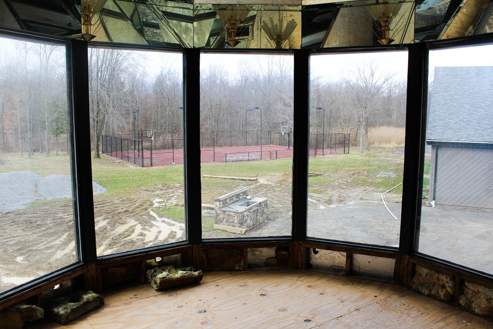 Looking out at 58 acres of beautiful woods, criss-crossed with paved paths, over the property of Mike Tyson's abandoned mansion in Southington, Ohio. <em>Seth Jovaag (TTBOOK)</em>