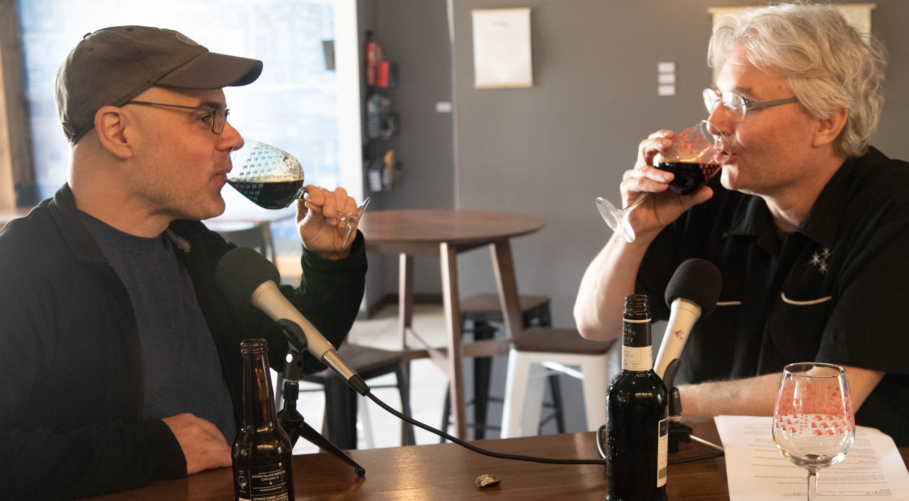 Josh Noel and Steve Paulson sample Goose Island Bourbon County Brand Stout (2014 and 2017) while chatting at the Funk Factory Geuzeria in Madison, Wisconsin. <em>Mark Riechers (TTBOOK)</em>
