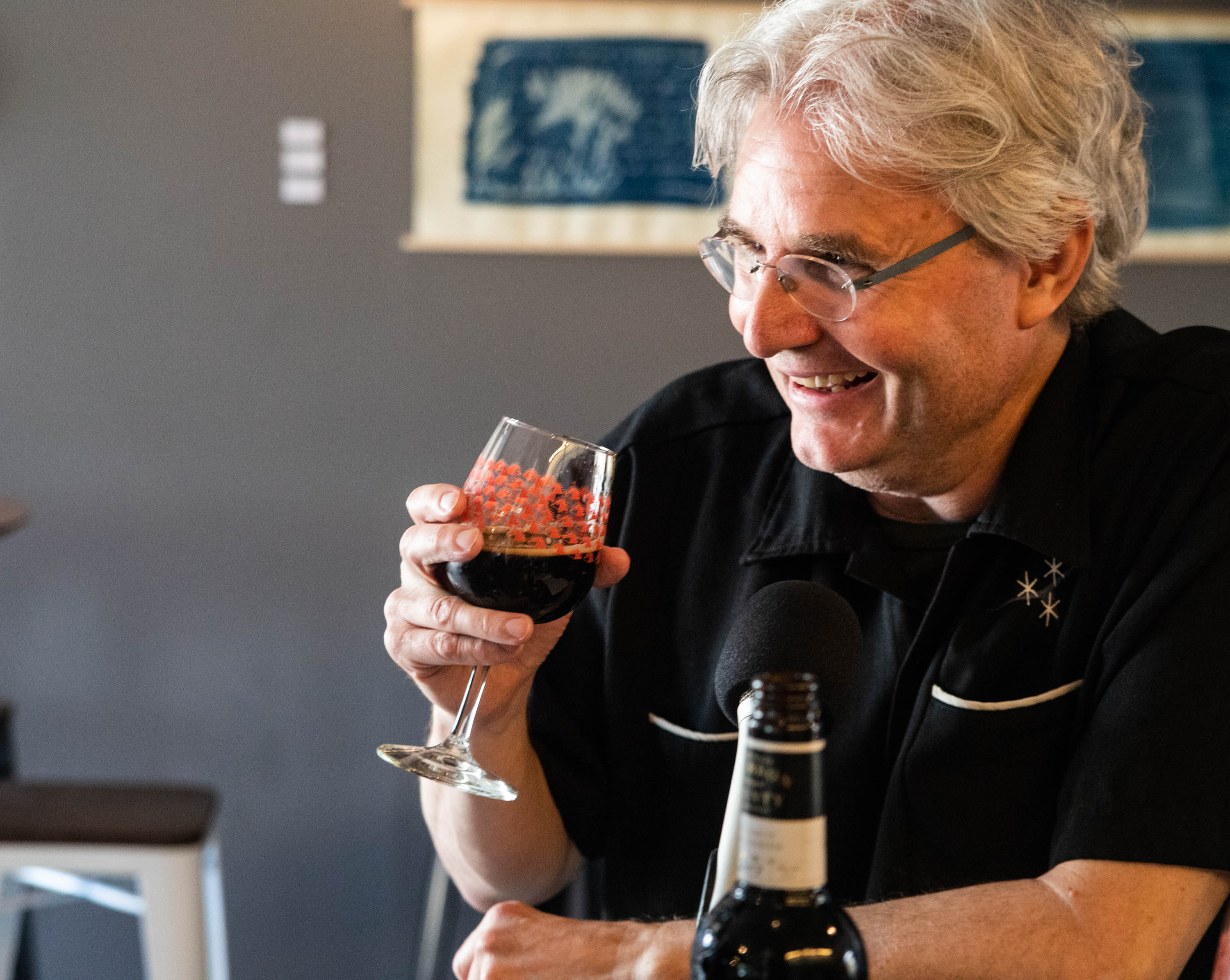 Steve Paulson samples Goose Island Bourbon County Brand Stout (2014 and 2017) while chatting at the Funk Factory Geuzeria in Madison, Wisconsin. <em>Mark Riechers (TTBOOK)</em>