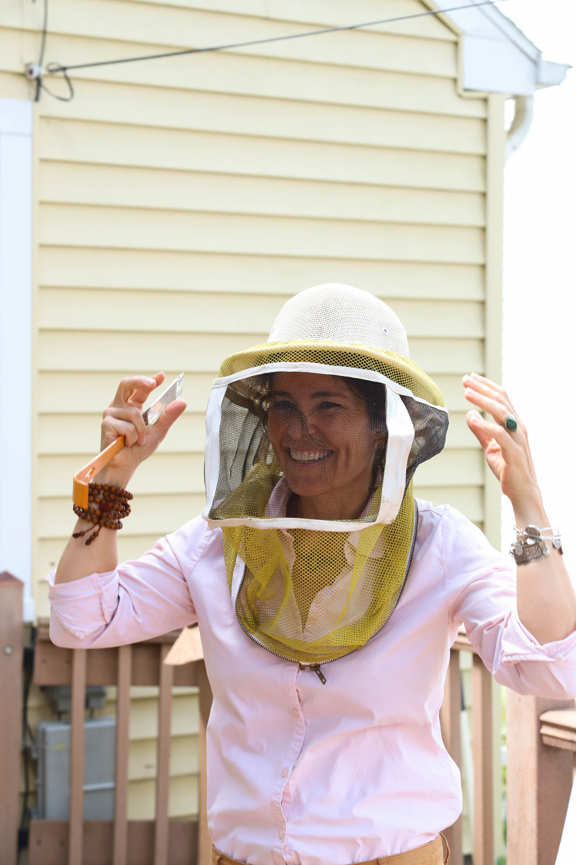 Heather dons her beekeeping gear. <em>Shannon Henry Kleiber (TTBOOK)</em>