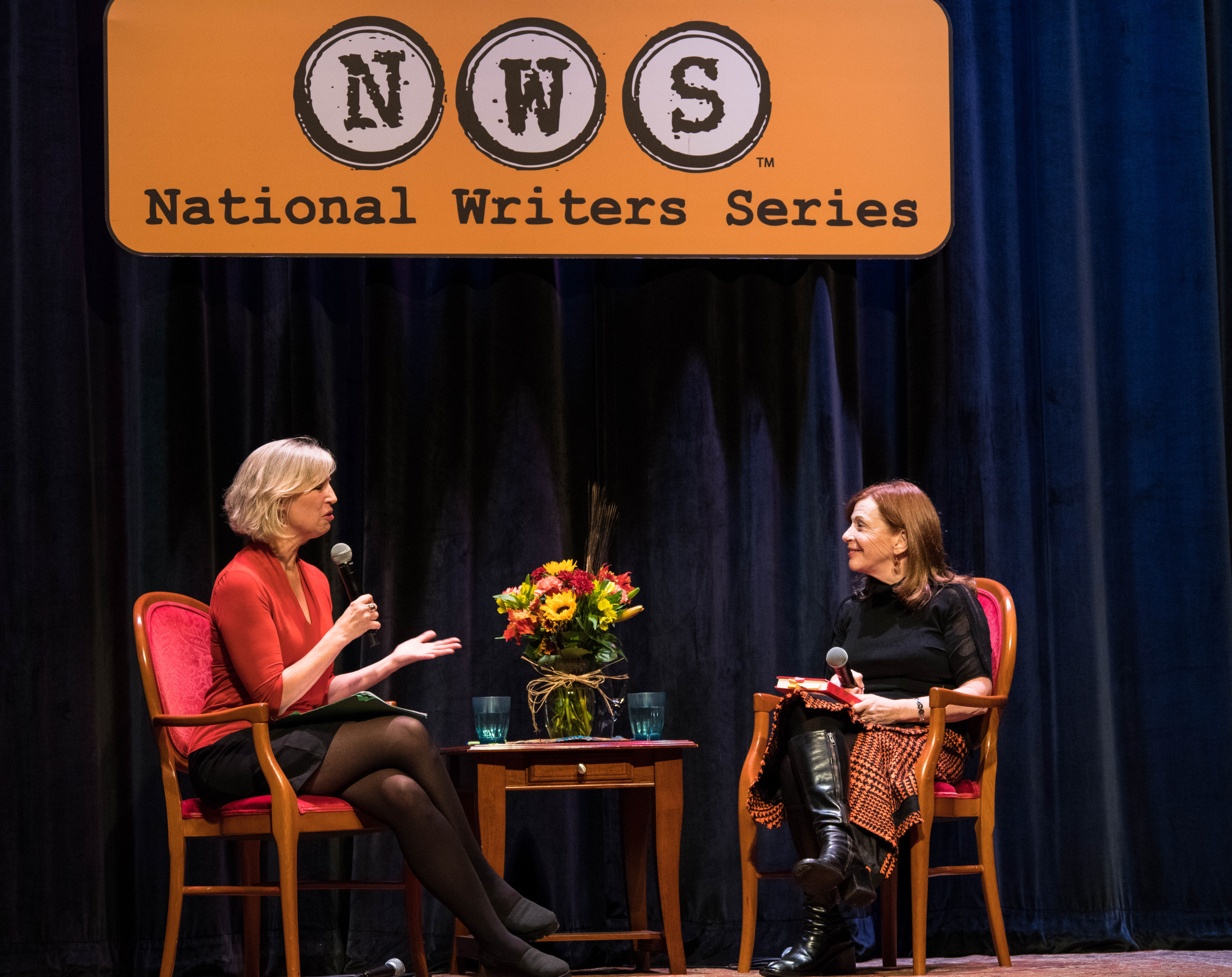 """To The Best Of Our Knowledge"" host Anne Strainchamps(left) interviews ""The Library"" author Susan Orlean live on stage at the National Writers Series in Traverse City, Michigan. <em>Tom Haxby/National Writers Series&nbsp;</em>"