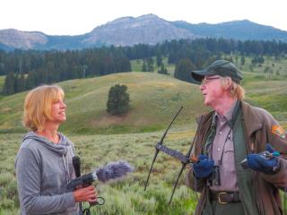 Anne interviews Rick McIntyre during a wolf watching session.