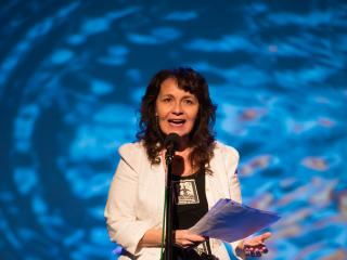 "Kim Blaeser on stage at ""Making Waves"" at Turner Hall."