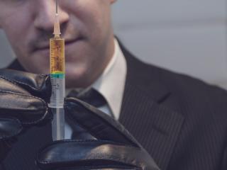 poisoner with needle