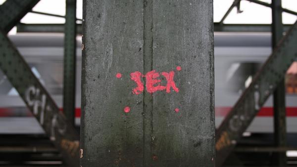 "The word ""sex"" on an iron pillar"