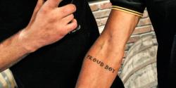 Eric, president of the Wisconsin chapter of the Proud Boys, shows off his tattoo, which is part of initiation into the group. Another ritual involves getting punched by other members while reciting breakfast cereal names. Photo taken Oct. 4, 2017.