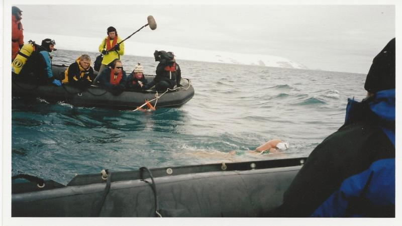 Cox was the first person to complete a 1.2 mile swim in Antarctica, from the ship Orlova to Neko Harbor in 25 minutes.