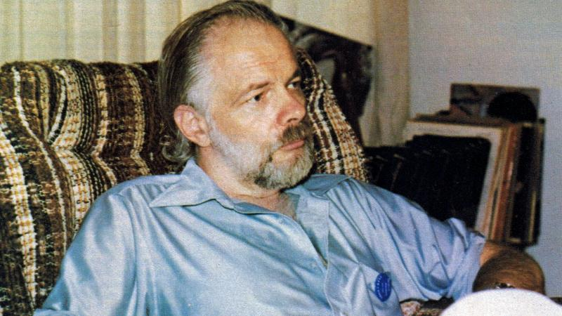 Philip K. Dick sitting in chair