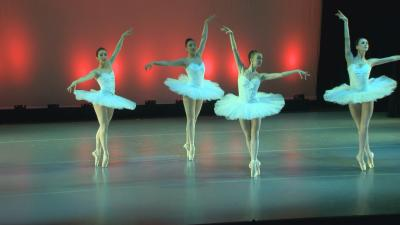 Four ballet dancers on stage