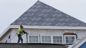 Roofing construction contractor