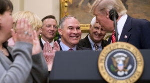 President Donald Trump shaking hands with Scott Pruitt