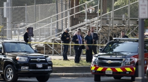Law enforcement officers investigate the scene of a shooting near a baseball field in Alexandria, Virginia