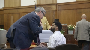 Dominique Heaggan-Brown speaks with his attorney Jonathan C. Smith