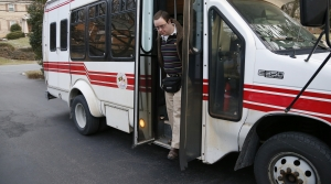 Matthew McMeekin getting off a bus
