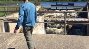 Chris Pierce oversees the removal of dam on the Maple River