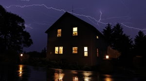 Home with lightening in the background