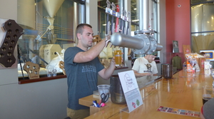 Bartender pouring a beer at Wisconsin Brewing