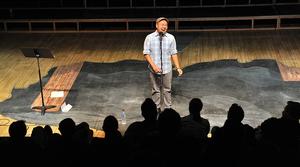 Man speaking at spoken word event