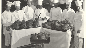 Carson Gulley poses with his chefs and a number of roast turkeys for Thanksgiving in November 1947.