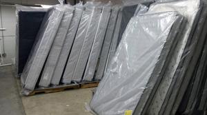 Donated mattresses in Milwaukee Homeless Veterans Initiative warehouse
