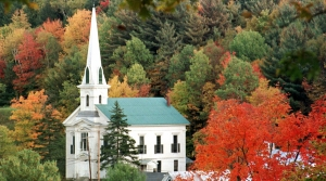 Colors of fall seen on trees frame a church
