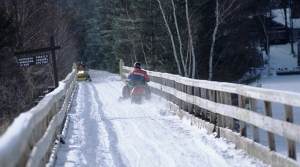 Snowmobiler crossing the Minocqua Trestle on the Bearskin State Trail.