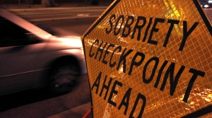 """""""Sobriety checkpoint ahead"""" sign"""