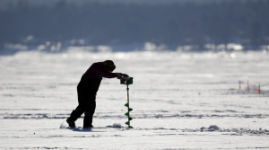Person ice fishing