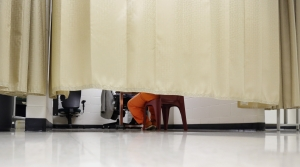 Inmate behind curtain