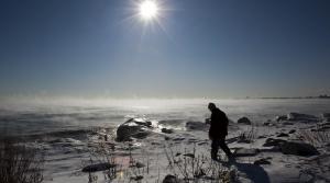 Man walking along Lake Superior