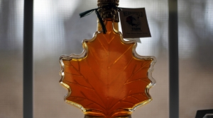 Maple syrup in a maple leaf-shaped bottle