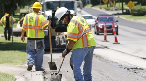 People working on repairing a road