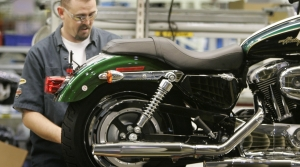 Man working on Harley Davidson motorcycle