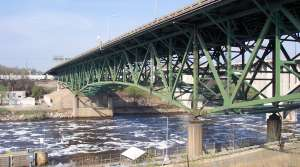 This 2005 image provided by John Weeks III shows the I-35W bridge north of Minneapolis. The busy highway bridge that spans the Mississippi River just northeast of Minneapolis collapsed during rush hour Wednesday, Aug. 1, 2007 sending dozens of cars, tons