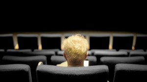 Person sitting in a theater