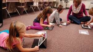 Students on tablets in a classroom