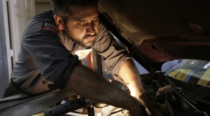 Mechanic Chris Geropoulos working on a car