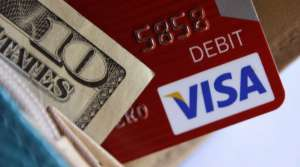Visa card and cash in a wallet