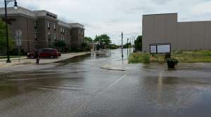 Streets in downtown Burlington, Wisconsin, remain flooded