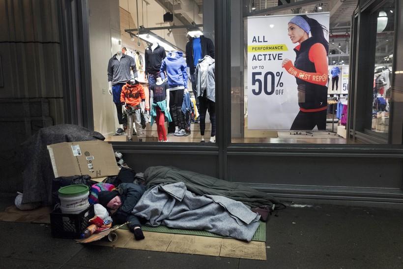 Person sleeping on the sidewalk