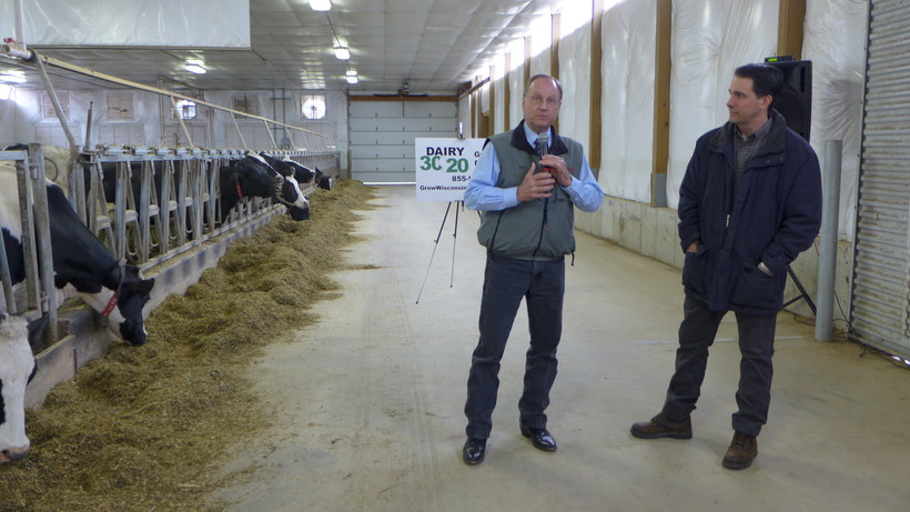 DATCP Secretary Ben Brancel (L) with Gov. Scott Walker (R) at Lane Creek Dairy in Barre Mills, shortly before Walker commented on this week's voter ID decision.